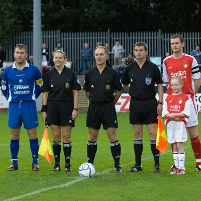 CAPTAINS AND OFFICIALS POSE FOR PHOTOGRAPHERS