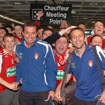 PLAYERS AND SUPPORTERS AT DUBLIN AIRPORT