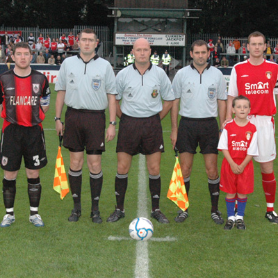 CAPTAINS AND OFFICIALS BEFORE GAME