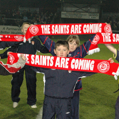 YOUNG SUPPORTERS WAVE ST PAT'S SCARVES
